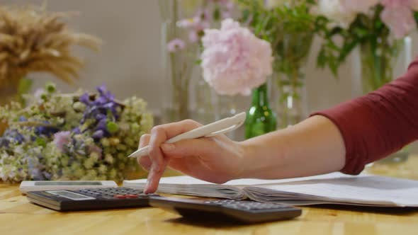 Thumbnail for Flower shop proprietor counting and writing