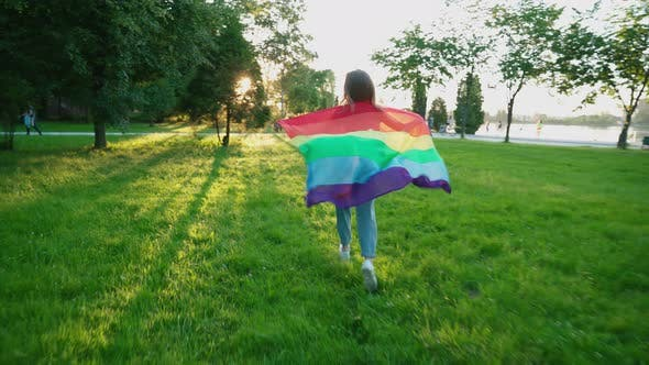 Thumbnail for Woman Holding Rainbow Flag, Showing Tolerance.