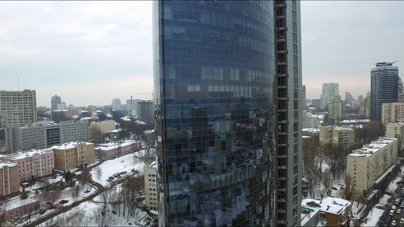 Thumbnail for Corporate Office Building in Winter City, Aerial View Glass Skyscraper