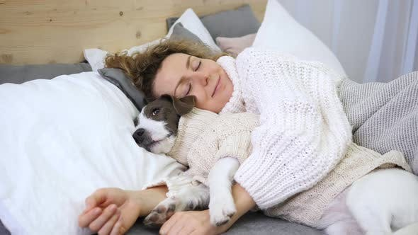 Thumbnail for Coziness, Home, Hygge, People And Animals Concept, Woman Sleeping With Dog In Bed