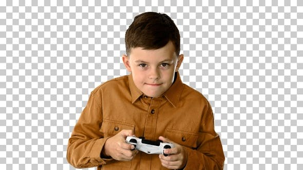 Emotional little boy playing video games, Alpha Channel