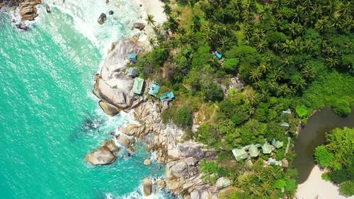 Beautiful birds eye clean view of a white sand paradise beach and aqua blue ocean background in vibr