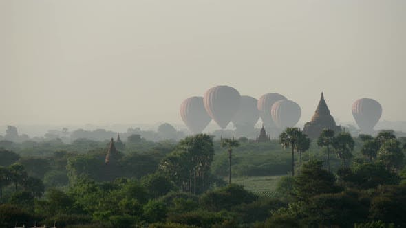Thumbnail for Balloons landing together close to the Pagodas