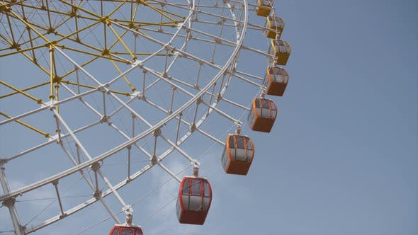 Thumbnail for Big Ferris Wheel Rotates at Amusement Park Ride Over Clean Blue Sky
