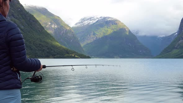 Thumbnail for Woman Fishing on Fishing Rod Spinning in Norway.