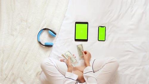 Female in Pajamas Counts Savings