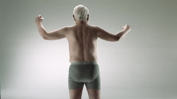 Thumbnail for Senior man flexing muscles