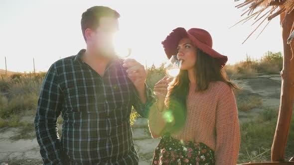 Thumbnail for Couple Tasting Wine in Warm Sunset Light