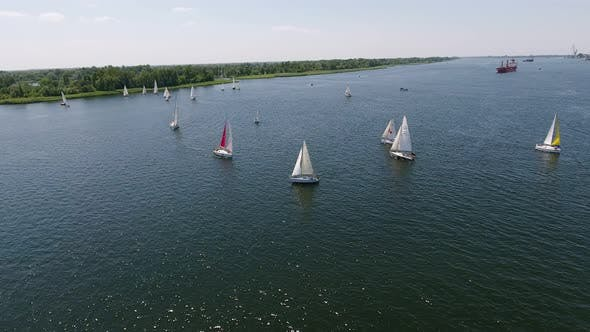 Thumbnail for Aerial Shot of One-mast Sailboats Floating in the Dnipro River on a Sunny Day