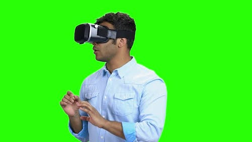 Portrait of Young Scared Man Using Virtual Reality Glasses