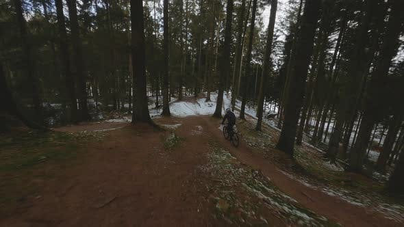 Drone On Cyclist In Snow Forest
