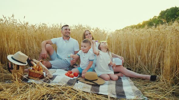 Happy Family at Picnic with Bubbles