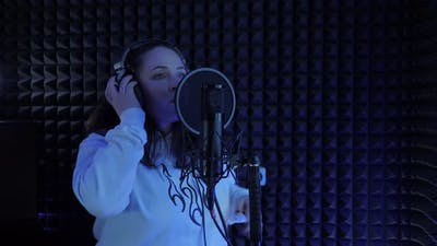 Singing in music recording studio