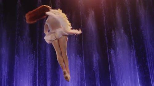 Aerial acrobat performing with neck loop