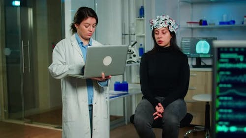 Medical Neurologist Doctor Asking Symptoms of Patient Taking Notes on Laptop