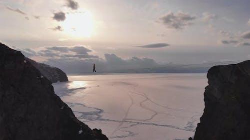 Tightrope Walker on the Horizon.
