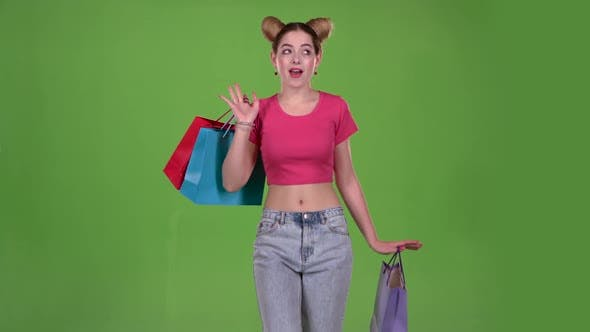 Thumbnail for Girl Goes Shopping with Bags in His Hands. Green Screen. Slow Motion
