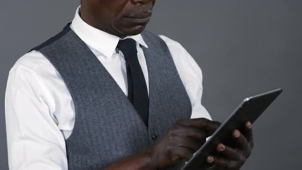 Thumbnail for Elegant African Man Using Digital Tablet