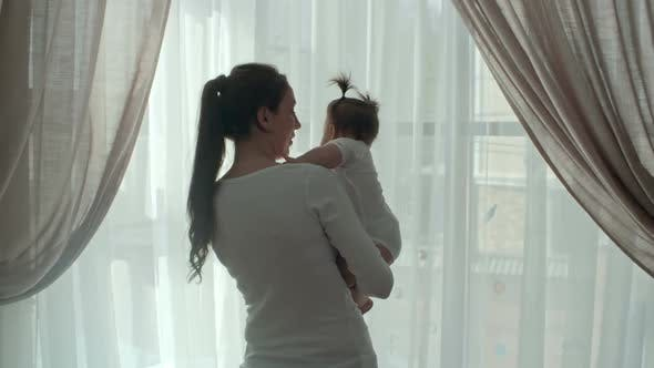 Thumbnail for Mother and Baby Looking Through the Window