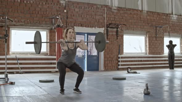 Thumbnail for Woman Squatting with Weighted Barbell