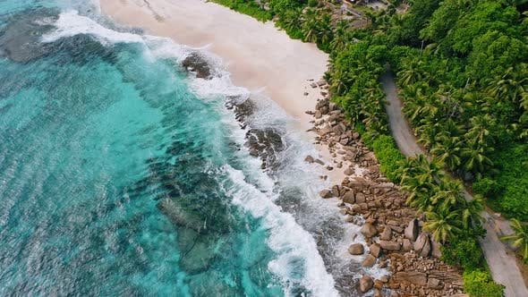 Thumbnail for Aerial View of Waves Breaking on the Rocks and White Beaches Surrounded By Coconut Palm Trees at