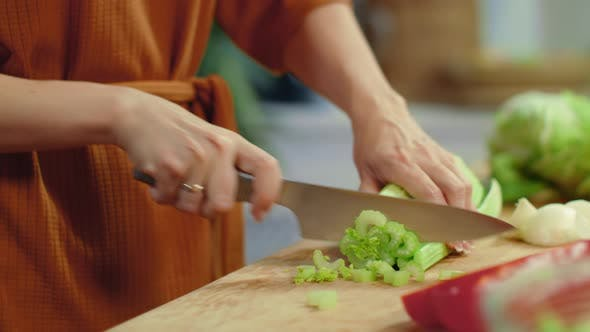 Thumbnail for Woman Hands Chopping Celery on Cutting Board. Housewife Cooking Fresh Vegetables