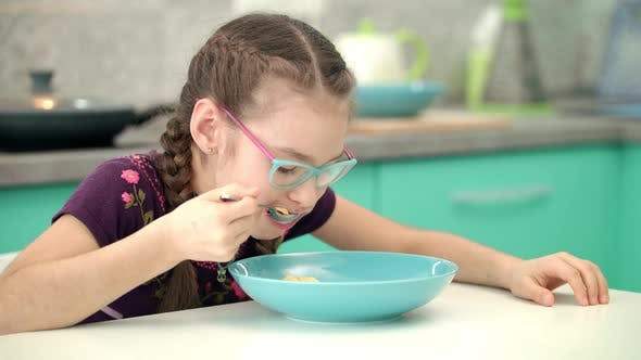 Thumbnail for Girl Eating Cornflakes at Kitchen