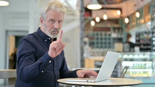Thumbnail for No, Finger Gesture By Old Man with Laptop in Cafe