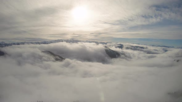 Thumbnail for Aerial Flyback Over Mountain Ridge With Rolling Fog Over Winter Snow
