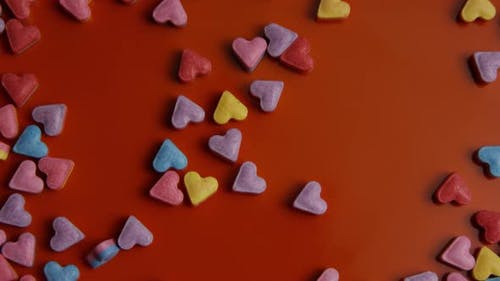 Rotating stock footage shot of Valentines decorations and candies - VALENTINES 0082