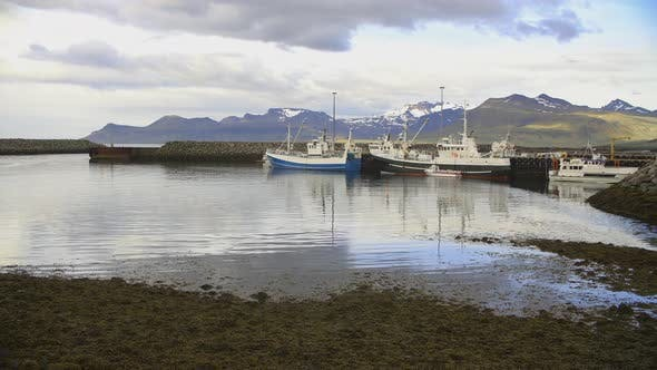 Cover Image for Northern Icelandic Port With Fishing Boats And Little Ships And Snow Mountains