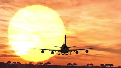 Silhouette airplane landing