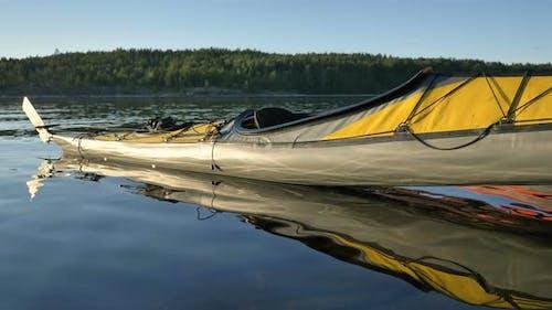 Yellow Sports Kayak on Water Near Bank of Tranquil Lake