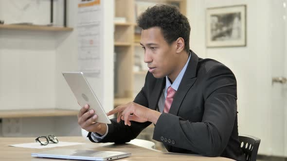 Thumbnail for African Businessman Celebrating Success While Using Tablet