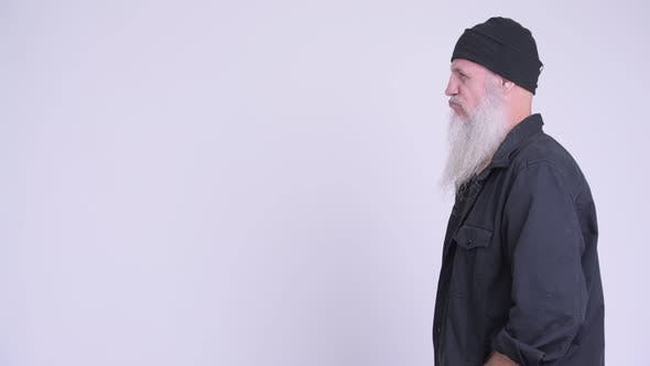 Thumbnail for Profile View of Mature Bearded Hipster Man Thinking