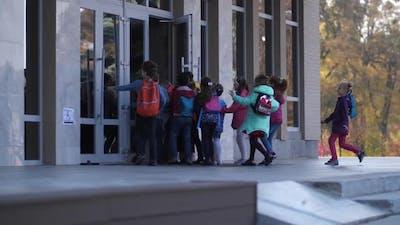 Junior School Students Running To School
