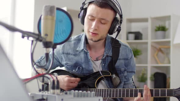 Thumbnail for Male Guitarist Recording Song at Home