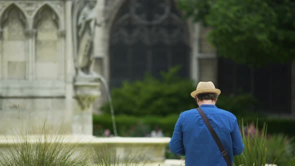 Thumbnail for Man Photographing Ancient Fountain of The Virgin and Notre Dame De Paris