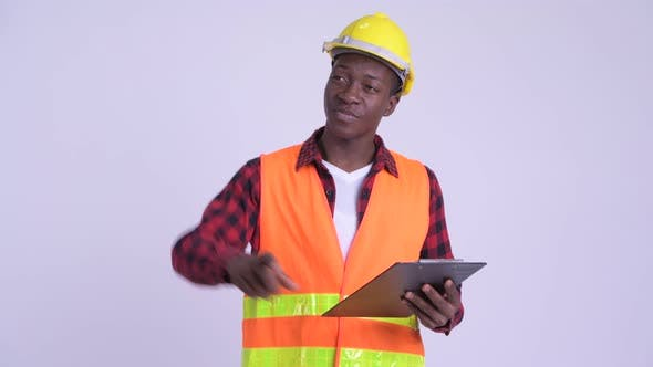Thumbnail for Young Happy African Man Construction Worker Directing While Holding Clipboard