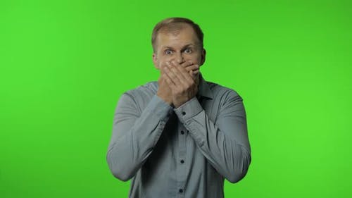 Man Isolated on Chroma Key Background. Closing Mouth with Hand, Gestures No, Refusing To Tell Secret