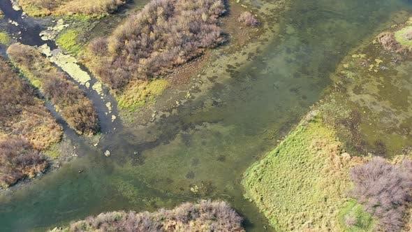 Aerial view looking down at marsh wetlands in Wyoming