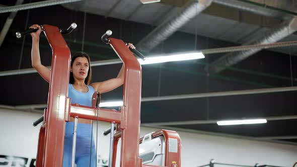 Thumbnail for Fit Woman Doing Pulling Up Exercise on Sport Trainer in Gym Club. Athlete Woman Training Pull Ups on