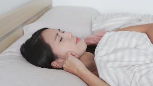 Woman suffer from noisy neighbor