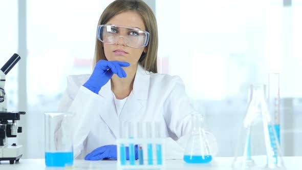 Thumbnail for Scientist Looking at Reaction Happening in Flask in Laboratory