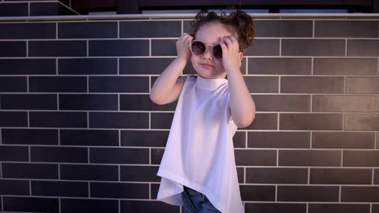 Little Girl Presents Designer Summer Clothes And Accessories