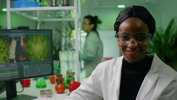 Portrait of Botanist African Woman Working in Microbiology Laboratory