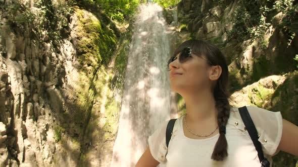 Woman Near Waterfall Enjoying Nature