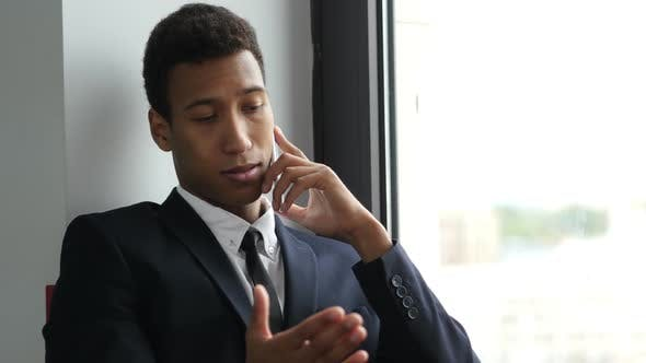 Thumbnail for Businessman in Suit Talking on Phone, Busy Negotiating