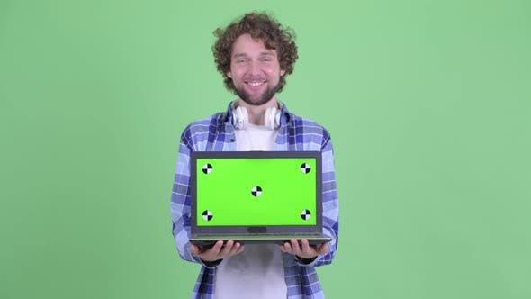 Thumbnail for Happy Young Bearded Hipster Man Showing Laptop