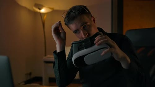 Young Caucasian Male in Spectacles Working with VR Helmet at Home
